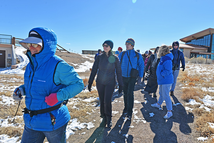 Chris Englert and Asher Millikan set out on their walk at the Rocky Mountain Arsenal National Wildlife Refuge. About 20 people, young and old, attended.