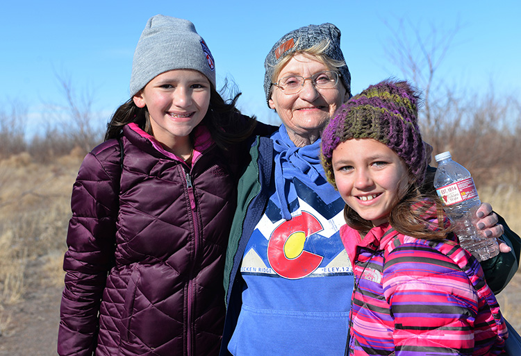 Katherine Patrick took her granddaughters Addison, left, and Fiona Patrick to walk through the Rocky Mountain National Wildlife Refuge. Photo by Meredi